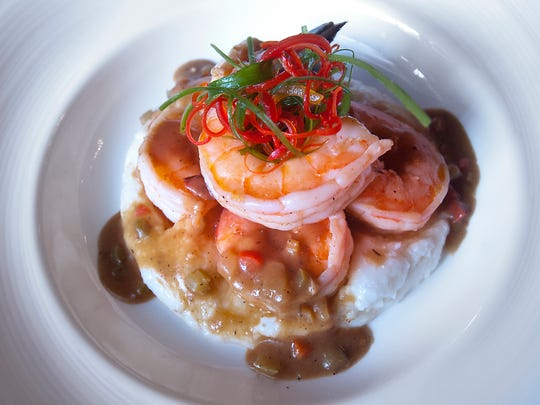 The Brown Hotel's shrimp and grits with creole sauce, scallion and red pepper crudo.