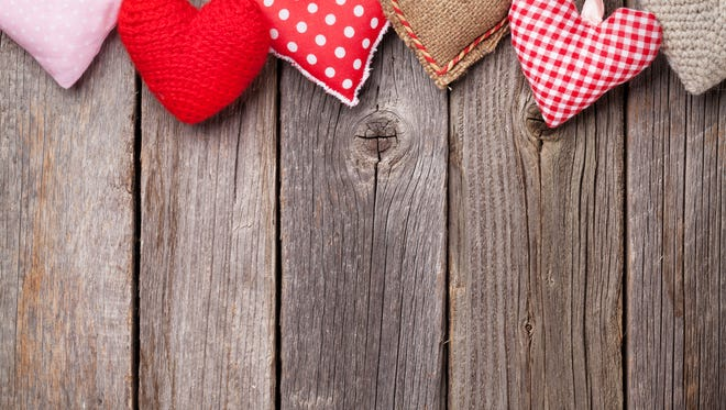 Valentines day hearts on wood.