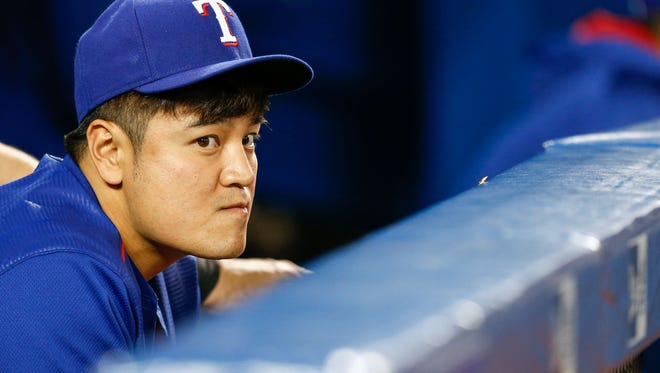 Texas Rangers right field Shin-Soo Choo (17) sits in dugout during an MLB game against the Toronto Blue Jays at Rogers Centre.
