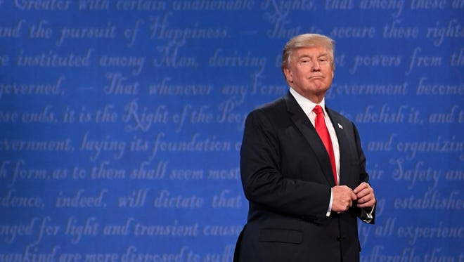 Republican presidential candidate Donald Trump at the conclusion of the third and final presidential debate at University of Nevada Las Vegas. Mandatory Credit: Robert Hanashiro-USA TODAY NETWORK