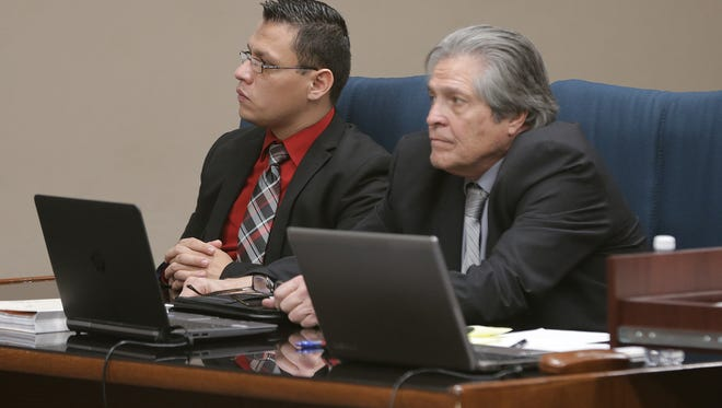 Antonio Lopez, left, listens to witnesses during his murder trial Monday in the 171st District Court. Lopez faces one count of capital murder of a person under 6 years old in the death of his 11-month-old foster daughter.