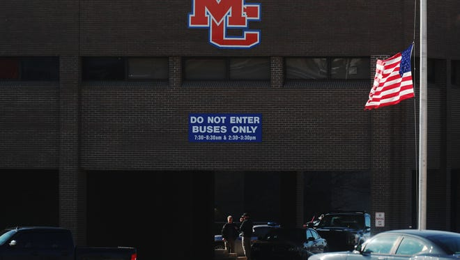 The American flag was at half-staff Wednesday at the Marshall County High School. The school was closed and still considered a crime scene as investigators continued to gather evidence. Two students were killed and 18 were injured Tuesday morning at Marshall County High School in Benton, Ky.