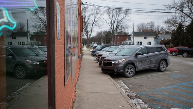 Cars parked on Washington Street in Marine City Thursday morning. Parking has been an ongoing frustration in Marine City, and the city has held various studies and discussions about solutions.