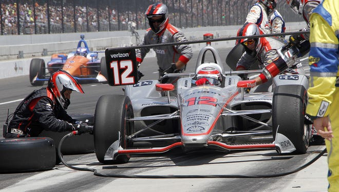 Team Penske IndyCar driver Will Power (12) gets a pit stop during the102nd running of the Indianapolis 500 at Indianapolis Motor Speedway on Sunday, May 27, 2018.