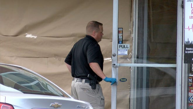 A Monmouth County Prosecutors office investigators enters the scene of a fatal shooting at the Bom DMais luncheonette and pizzeria at 545 Broadway in Long Branch Tuesday evening.