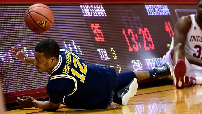 Michigan guard Muhammad-Ali Abdur-Rahkman dives for a loose ball against Indiana on Feb. 12, 2017.