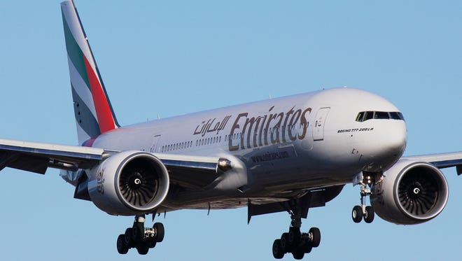 An Emirates airline Boeing 777-200LR flies near Everett, Wash., in this 2009 file photo.