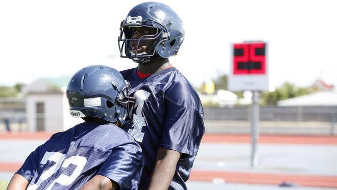 True freshman Greg Little (right) appears to be in a position to start at left tackle this season.