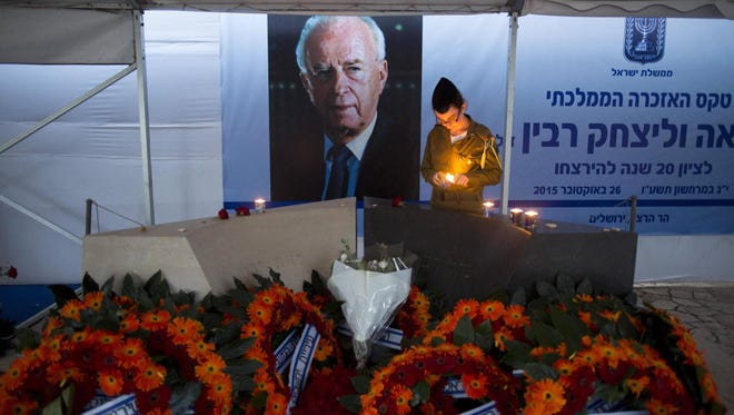 An Israeli soldier lights a candle at Yitzhak Rabin's grave in Jerusalem on Oct. 29, 2015.