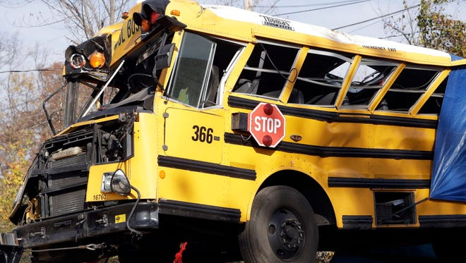 A crashed school bus is carried away on Nov. 22, 2016, in Chattanooga, Tenn.