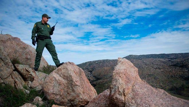 Border patrol agent near the U.S.-Mexico border in Tecate, Calif.