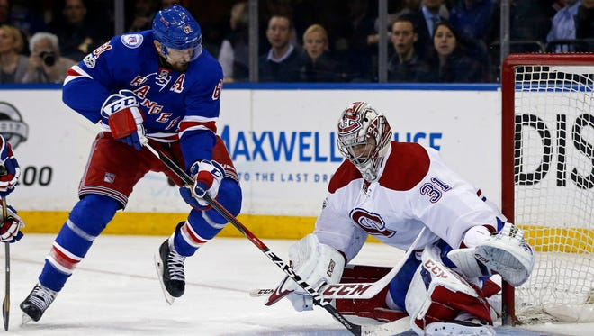 New York Rangers forward Rick Nash (61) scores a goal past Montreal Canadiens goalie Carey Price (31) during the second period in Game 4.