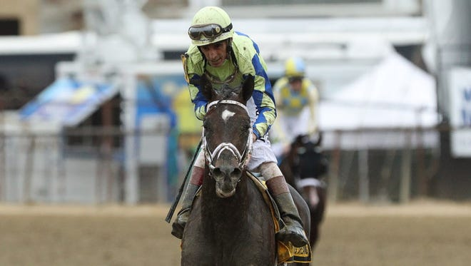 John Velazquez aboard Always Dreaming reacts after the 142nd running of the Preakness Stakes at Pimlico Race Course in Baltimore.