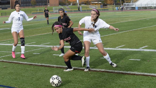 Cliffside Park senior Jessica Moreno (center) helped lead the Red Raiders to 13 wins.