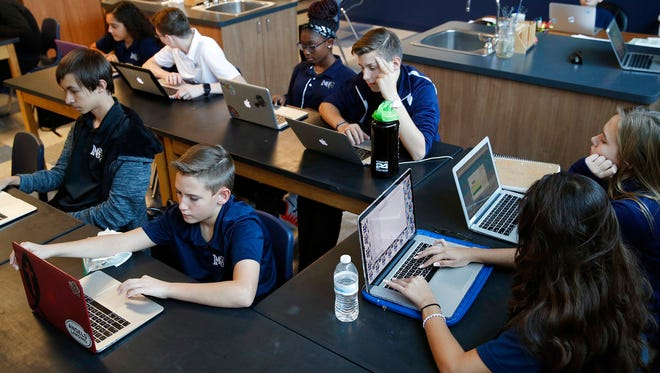 In this Nov. 16, 2017, photo, students work on computers in a freshman biology class at Lake Mead Christian Academy in Henderson, Nev.
