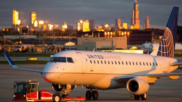An Embraer E170/75 gets a tow across Chicago O'Hare