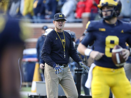Jim Harbaugh watches his players go through drills before action against Ohio State on Nov. 25 at Michigan Stadium.