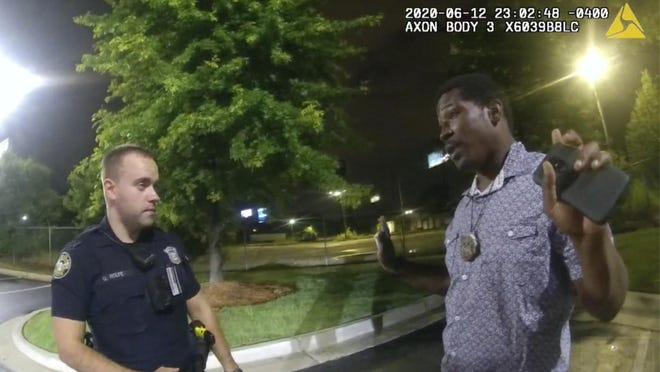 ATLANTA -- This screen grab taken from body camera video provided by the Atlanta Police Department shows Rayshard Brooks speaking with Officer Garrett Rolfe in the parking lot of a Wendy's restaurant late Friday. Rolfe has been fired following the fatal shooting of Brooks, and a second officer has been placed on administrative duty.