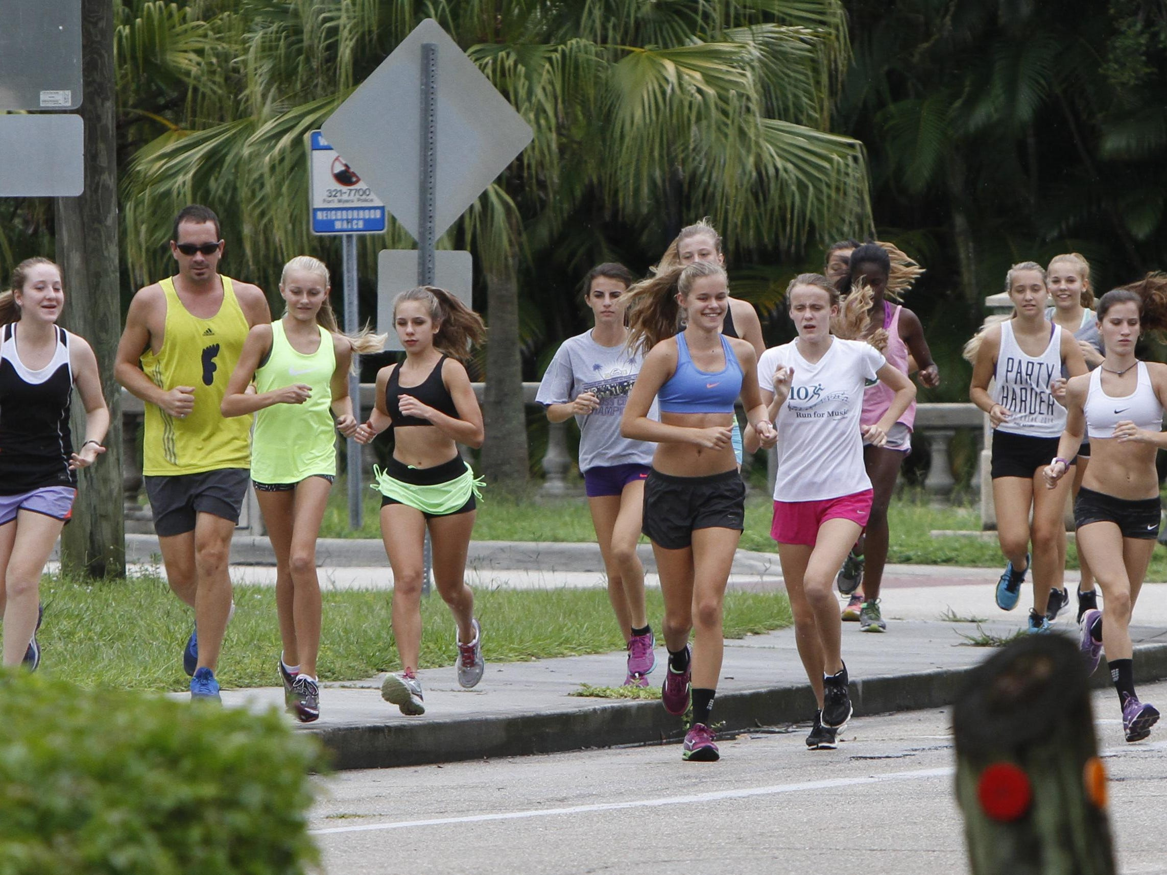 Members of the Fort Myers High School girls cross country team run near the school Friday, August 28.