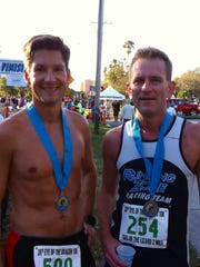 Winner John Davis with second-place finisher Steve Hedgespeth after the 10K race of the Eye of the Dragon in Eau Gallie.