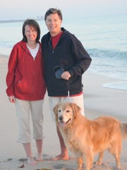 Pamela and Adrian Pettyan with their dog, Karu