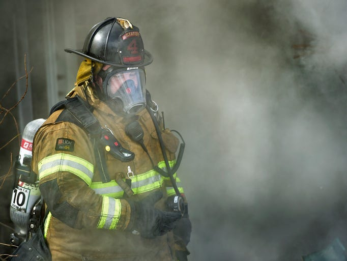 Firefighters battle a house fire at 233 Newville Road