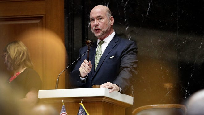 Speaker of the House Brian Bosma strikes his gavel following the passage of a bill on the final day of the legislative session on March 14, 2018.