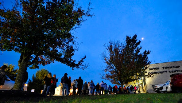 Voters line up outside the Dover Township Fire Department