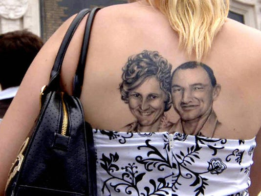 An Australian woman, with her back tatto