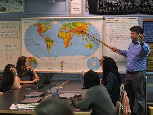 Paul Beavers teaches a world history class at Hillsboro High School in Nashville.