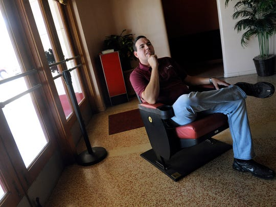 Rhyne Hobbs sits in the lobby of Eastland's Majestic Theater Thursday Sept. 14, 2017 in an example of one of the new chairs coming to the movie house this week.
