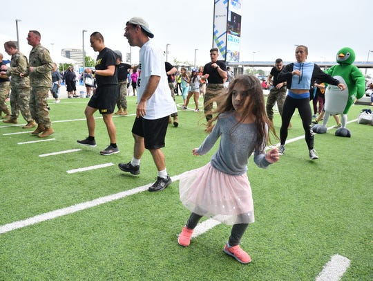 Koiren Rivera,6, of Jersey City works out with U.S.