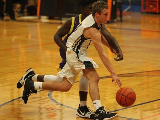 Brady High School's Cole Bryant (foreground) tries