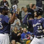 Jonathan Lucroy (20) and Chris Carter (33) each homered Sunday in the Brewers' 3-2 win over the Padres.