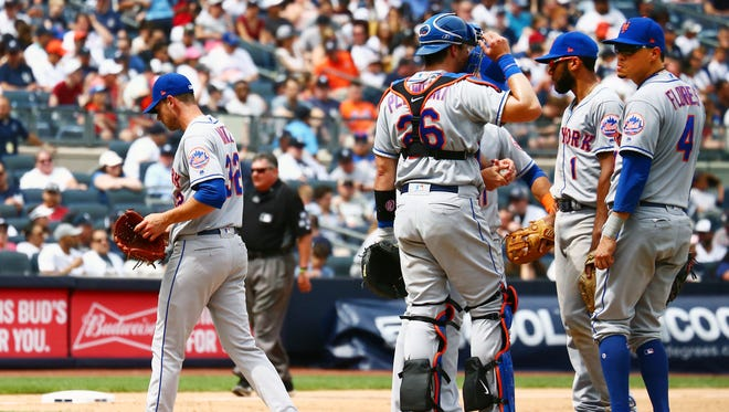 Jul 21, 2018; Bronx, NY, USA; New York Mets starting pitcher Steven Matz (32) leaves the mound after being taken out of the game against the New York Yankees during the sixth inning at Yankee Stadium.