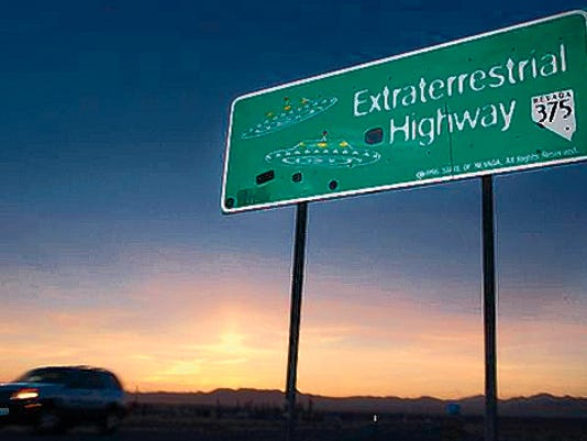 "A car moves along the Extraterrestrial Highway in 2002 near Rachel, Nevada, the closest town to Area 51. The Air Force is giving an ultimatum to owners of a remote Nevada property: Take 5.2 million ""last best offer"" by Sept. 10 or the government will seize it."