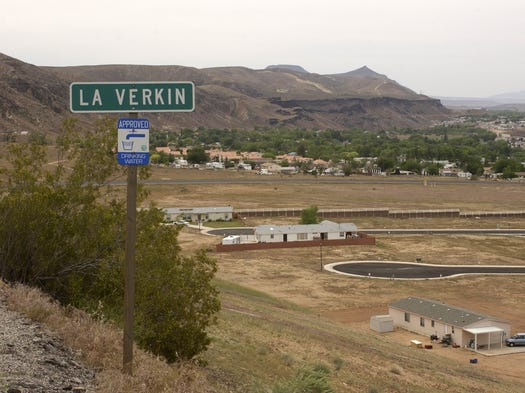 In May of 2002, Spectrum & Daily News photo editor Nick Adams took the then image looking out over the town of LaVerkin from state Route 9 as it twists up the hill towards Virgin. Just three home can be seen in the subdivision at the bottom of the hill. Just a dozen years later, most of the empty lots in the subdivision have been built upon as can be seen in the now image taken by Spectrum photo editor Jud Burkett. On the far side of state Route 9, not much has changed between the two images although if you look closely there are a few new homes and a number of the trees in down town LaVerkin have gotten taller.
