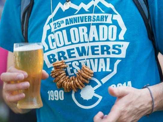 An attendee wears a pretzel necklace during the Colorado
