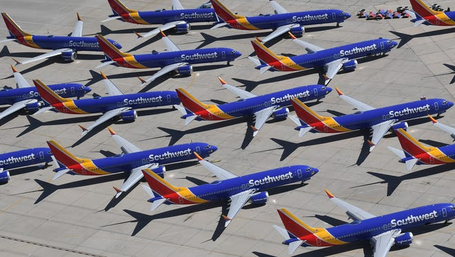 Southwest Airlines Boeing 737 MAX aircraft are parked on the tarmac after being grounded, at the Southern California Logistics Airport in Victorville March 28. After two fatal crashes in five months, Boeing is trying hard to present itself as unfazed by the crisis that surrounds the company.