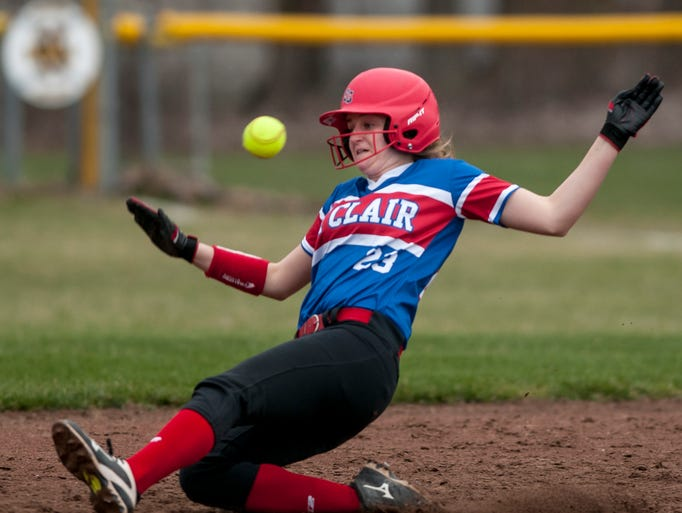 St. Clair's Alexis Churchill beats the ball and slides