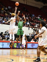 Novi's Traveon Maddox, Jr. (2) launches the game-winning floater at the buzzer over Belleville's Connor Bush in the Class A quarterfinal.