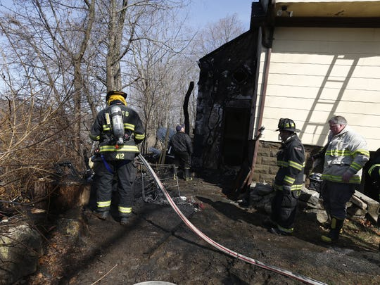 Heavy fire and smoke damaged the back of a 2-story house at 81 Washington Ave. in North White Plains Thursday.