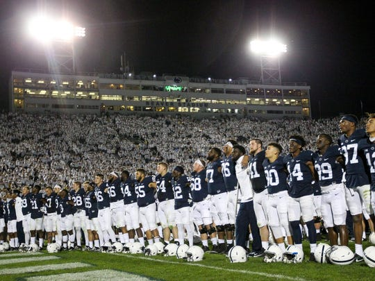 Penn State Nittany Lions players sing the alma-mater following the competition of the game against the Michigan Wolverines at Beaver Stadium. Penn State defeated Michigan 42-13.
