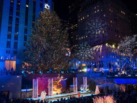 rockefeller christmas tree lighting attracts thousands