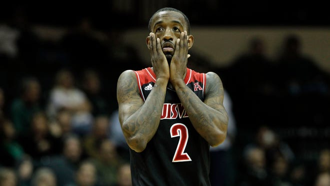 Louisville Cardinals guard Russ Smith (2) reacts after he hurt his right eye against the South Florida Bulls  during the first half at USF Sun Dome.