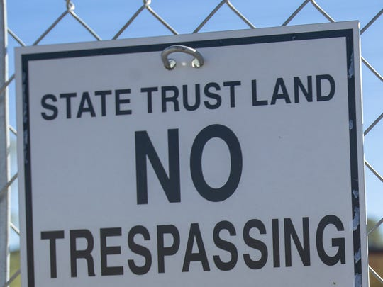 The state has posted 'No Trespassing' signs near property in downtown that has been in ownership dispute for about 15 years.