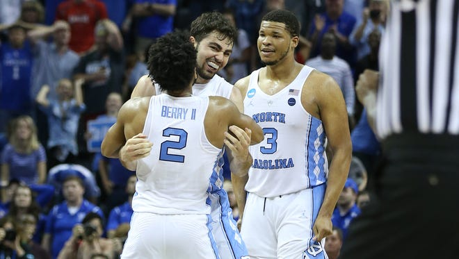 Mar 26, 2017; Memphis, TN, USA; Mar 26, 2017; Memphis, TN, USA; North Carolina Tar Heels forward Luke Maye (32) reacts with guard Joel Berry II (2) and forward Kennedy Meeks (3) after making a basket with .3 seconds left against the Kentucky Wildcats in the second half during the finals of the South Regional of the 2017 NCAA Tournament at FedExForum. North Carolina  won 75-73. Mandatory Credit: Nelson Chenault-USA TODAY Sports