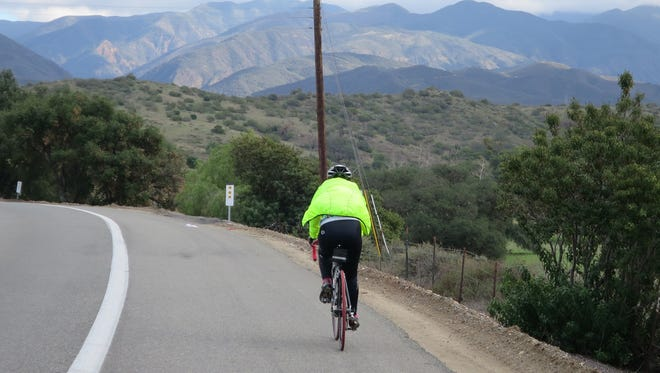 A cyclist enjoying the view on East Santiago Canyon Road.