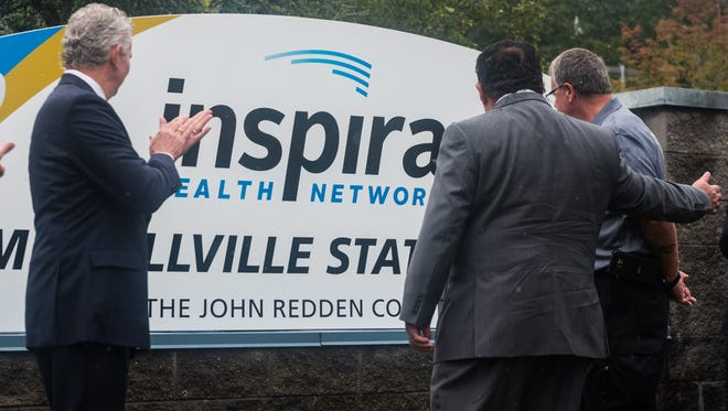Inspira EMS Millville Station's new sign is unvield during the welcoming of new Inspira employees at Inspira's EMS Millville Station on Wednesday, September 6.