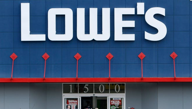 Customers enter and exit a Lowe's store in Saugus, Mass.